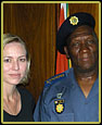Lisa Henry and Shareen Anderson with South African National Police Commissioner Bheki Cele while shooting a documentary about the South African Police.